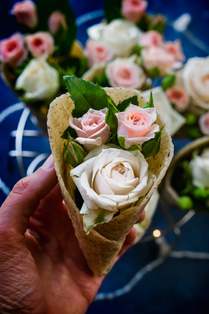 Holding a vegan waffle ice cream cone with a bouqet of roses.