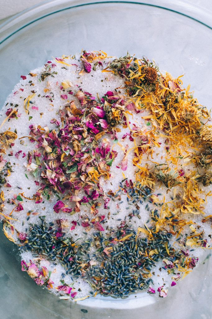 Mixture of all of the herbs to make the herbal bath salts in a bowl.