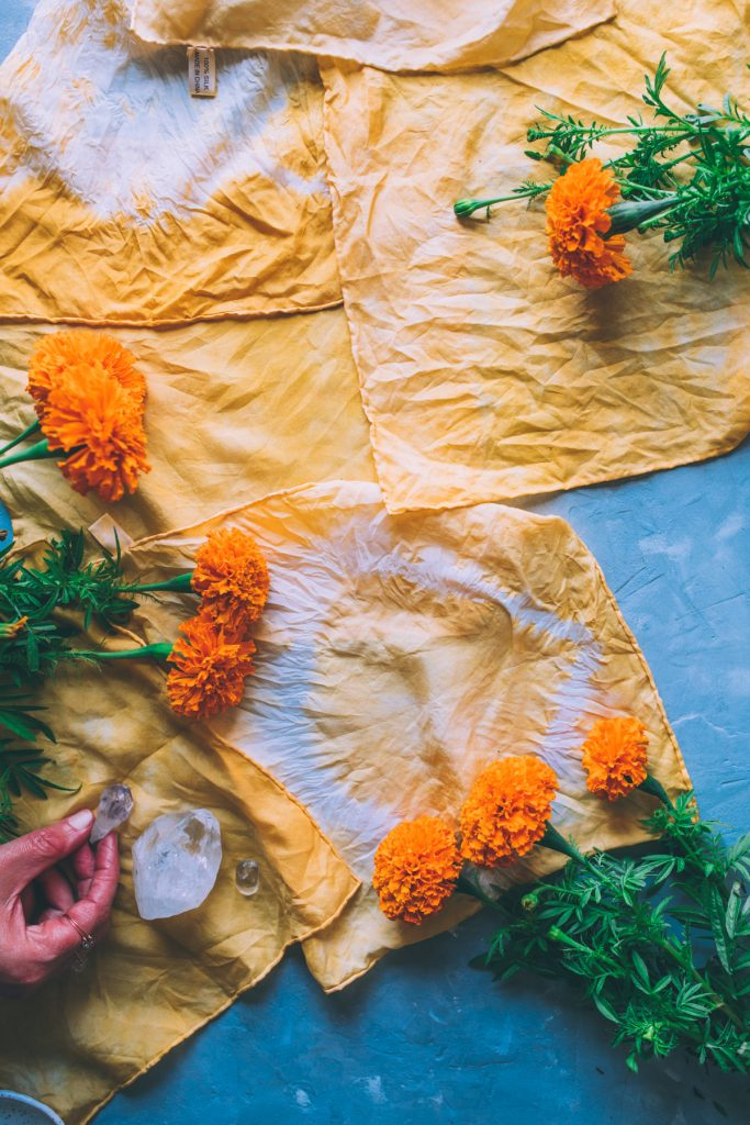 Marigold flowers, tea towels and crystals.