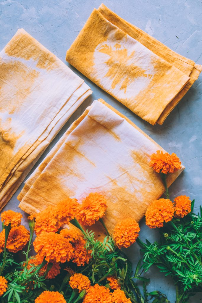Marigold flowers and tea towels