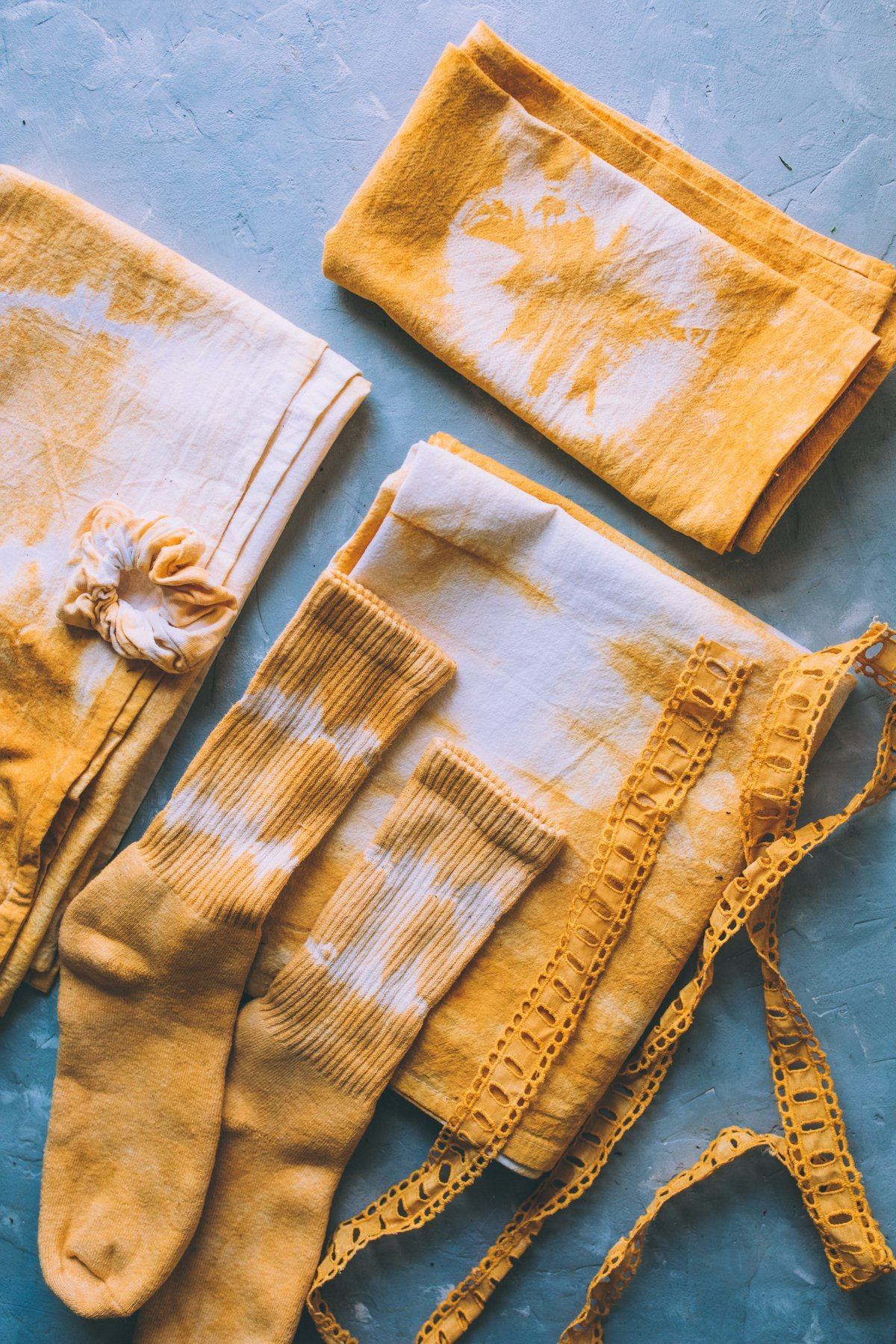 Socks, towels and lace naturally dyed with Marigold flowers