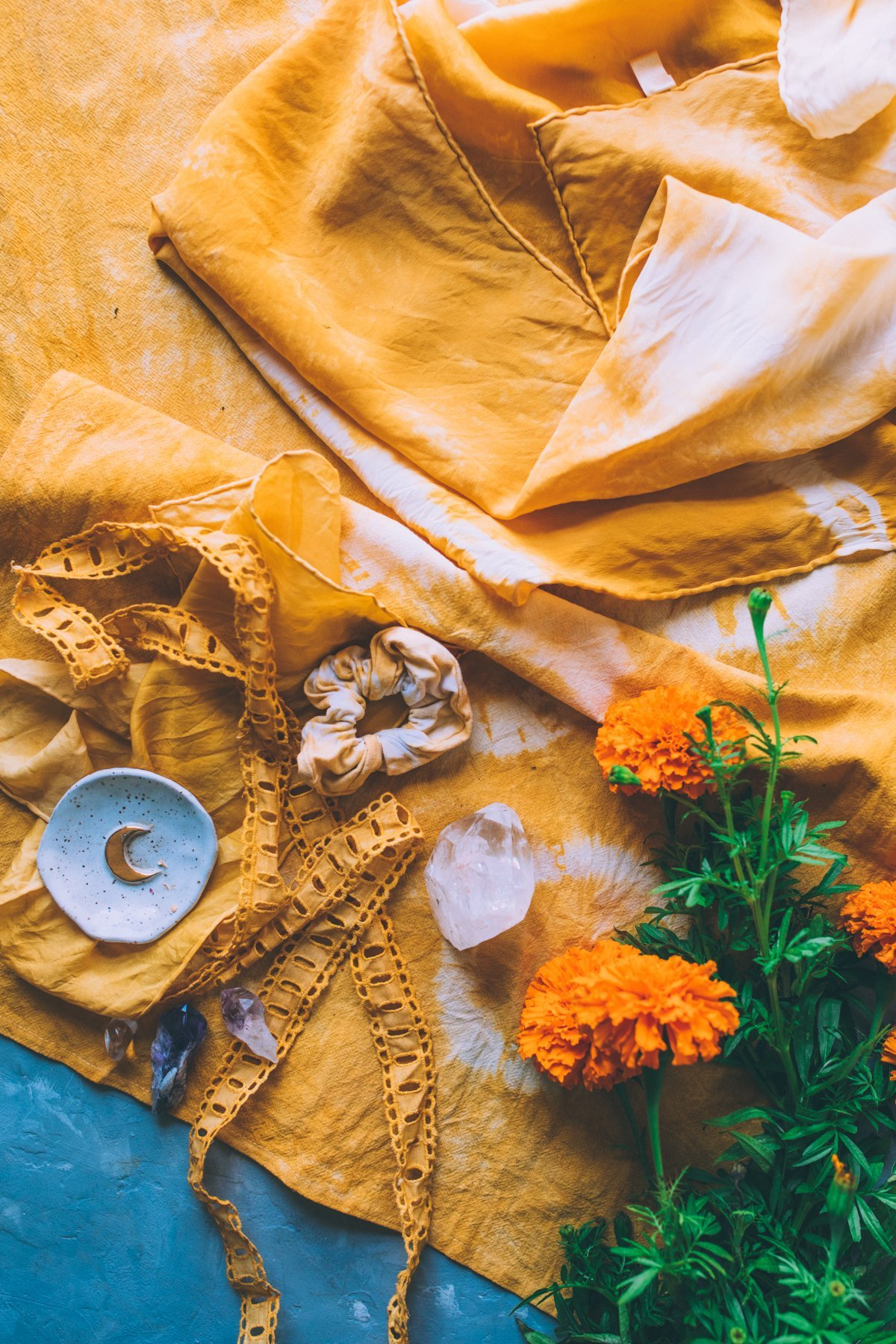 Marigold flowers, tea towels, and lace