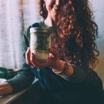 Me holding a mason jar of the bath salts