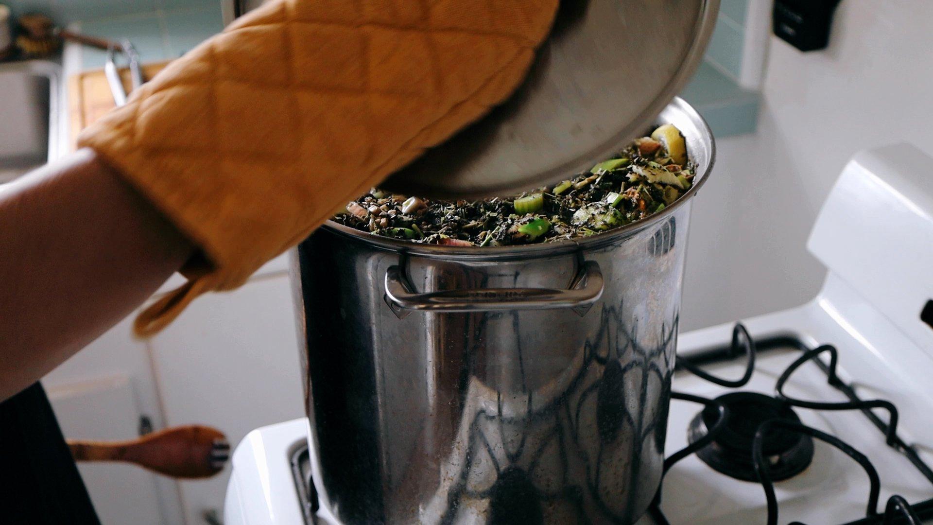 placing lid on herbal bone broth